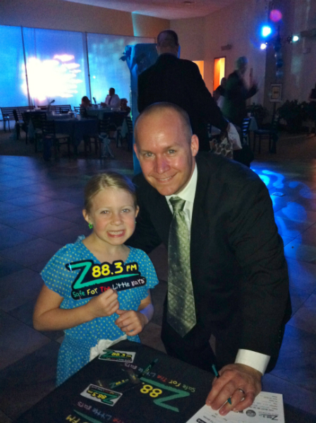 Father daughter Z88.3 listeners stopped by the Z88.3 table to say hi.
