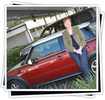 Judy Wise standing beside her Mini