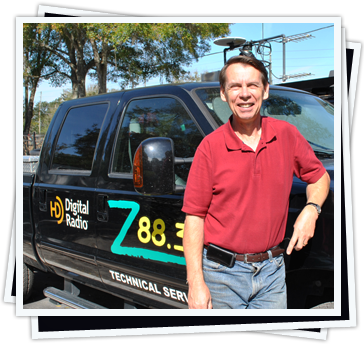 Mark Chambers standing beside the Z88.3 Technical Services Truck