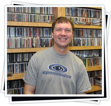 Tim Wolf standing in the Z88.3 Music Library